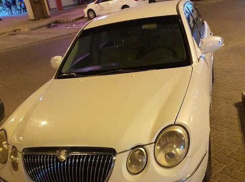 kia opirus 2009 white car for sale - 自動車/オートバイ