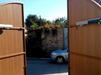 1800 Garage Doors (1) - Home & Garden Services