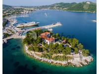 Property Greece (4) - Onroerend goed sites