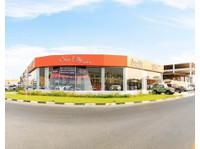 Sun City Motors (2) - Car Dealers (New & Used)