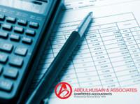 Abdulhusain & Associates Chartered Accountants (2) - Financial consultants