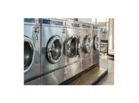 Wash 'n Dry Laundry Gator (1) - Home & Garden Services