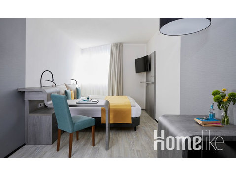 Apartment with kitchenette on the banks of the Isar near… - Apartments