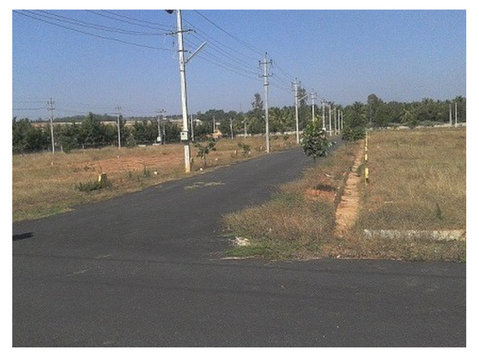 plots for sale airport road - Land