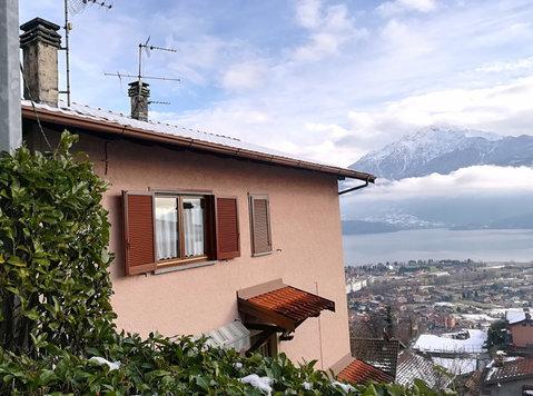 Appartamento ampio vista lago - Vakantiewoningen