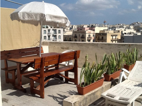 Share a nice Penthouse right in st. Julian's city center - Flatshare
