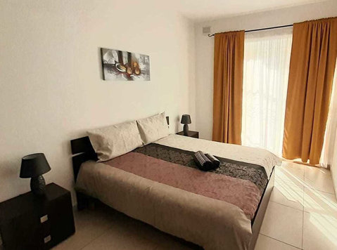 Bright second floor apartment with lift in St Julians - Apartments