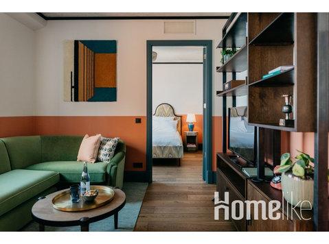 Un appartement avec une chambre - Appartements